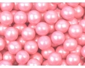Pink pearlized sixlets is a unique topping for frozen yogurt. Candy coated chocolate topping.